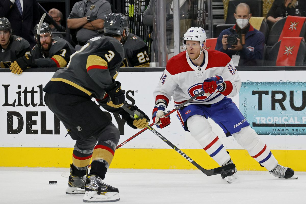 Corey Perry #94 of the Montreal Canadiens is defended by Brayden McNabb #3 of the Vegas Golden Knights during the third period in Game 5 of the Stanley Cup Semifinals of the 2021 Stanley Cup Playoffs at T-Mobile Arena on June 22, 2021 in Las Vegas, Nevada.