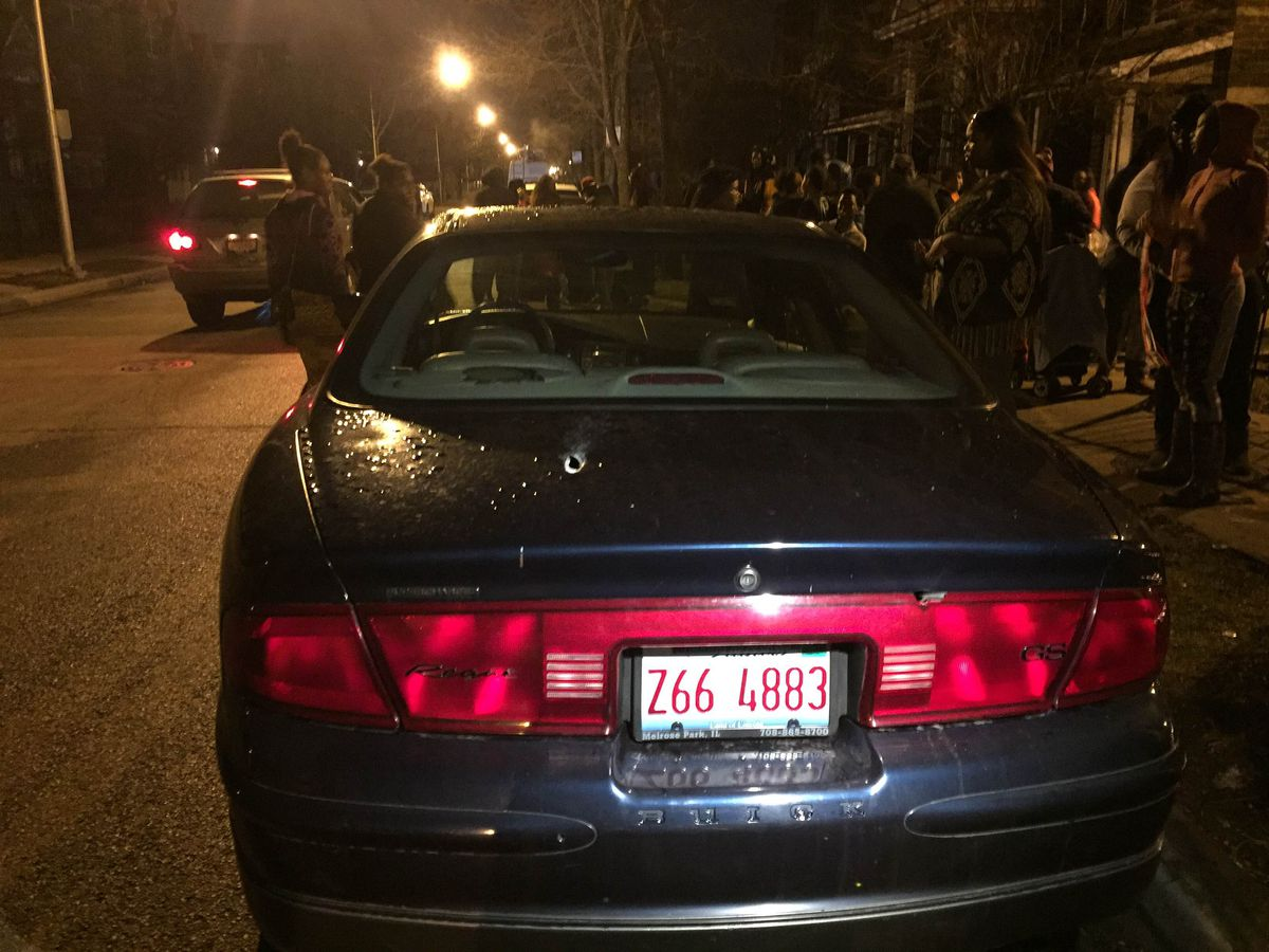 A bullet hole is apparent in the trunk of the car at the scene where Daysha Wright was fatally shot early Wednesday. | Sam Charles/Sun-Times