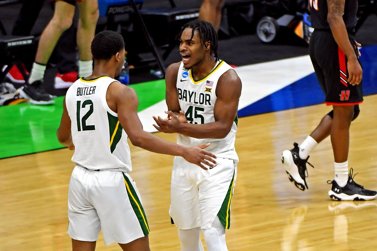 Baylor Bears guard Jared Butler and guard Davion Mitchell react during the first half against the Hartford Hawks in the first round of the 2021 NCAA Tournament at Lucas Oil Stadium.