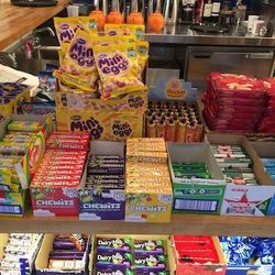 At the candy counter, find Irish and English treats including Chewits and Sherbet Fountains.