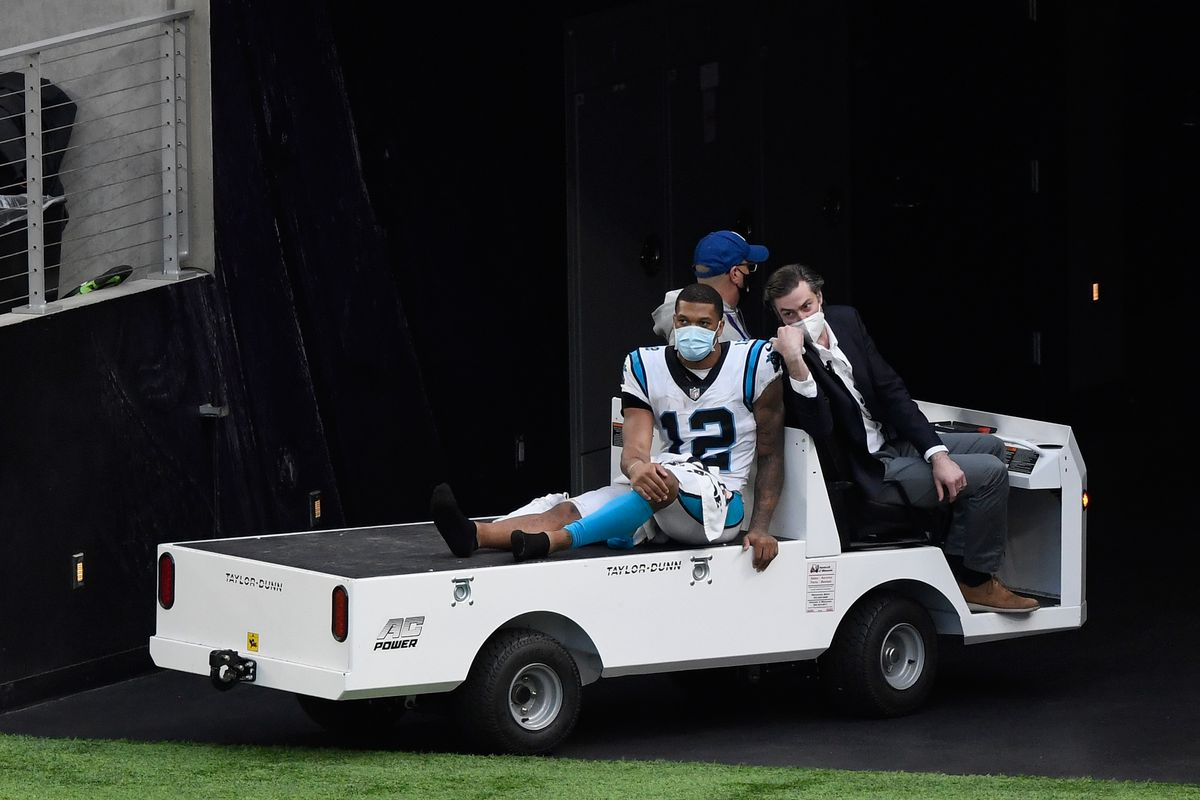 D.J. Moore #12 of the Carolina Panthers is carted off the field after an injury against the Minnesota Vikings during the fourth quarter of the game at U.S. Bank Stadium on November 29, 2020 in Minneapolis, Minnesota.