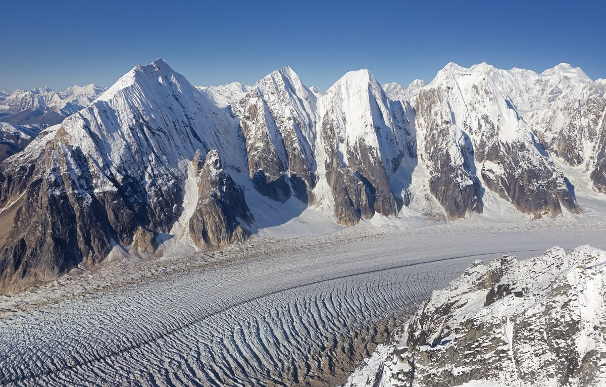 Alaskan mountains and glaciers covered in snow.