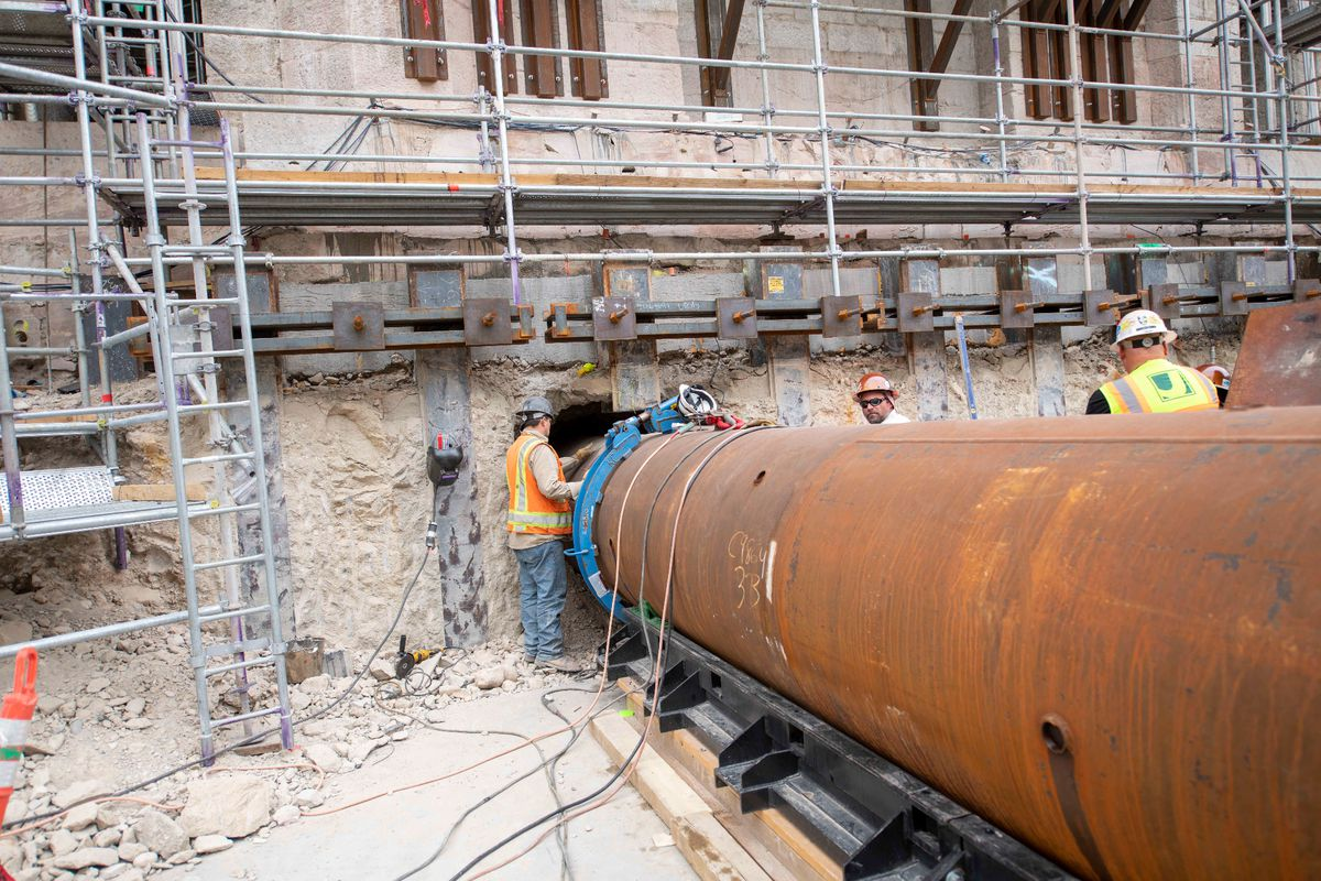 Pipes 40-feet-long are used to strengthen the temple's foundation against earthquakes, Salt Lake City, Utah, Sept. 2021.