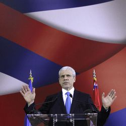 FILE - March 2, 2012 file photo of Serbia's President Boris Tadic as he speaks and gestures during a press conference, in Belgrade, Serbia. Tadic said Wednesday April 4 2011 that he is resigning, paving the way for an early presidential election where he will face a strong challenge from a nationalist candidate. In the presidential vote, Tadic will be challenged by nationalist candidate Tomislav Nikolic who has received tacit support from Russia.