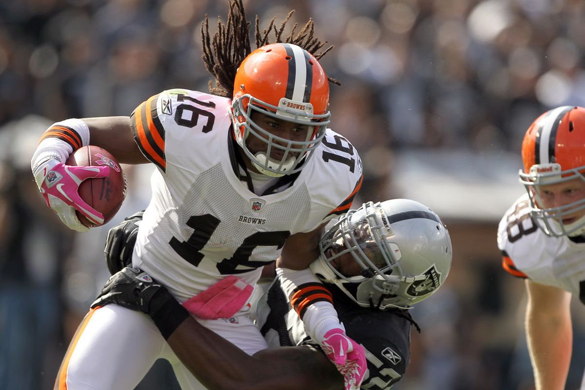 OAKLAND, CA - OCTOBER 16:  Josh Cribbs #16 of the Cleveland Browns is tackled by Quentin Groves #52 of the Oakland Raiders at O.co Coliseum on October 16, 2011 in Oakland, California.  (Photo by Ezra Shaw/Getty Images)