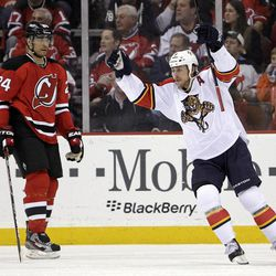Florida Panthers' Stephen Weiss, right, celebrates a goal scored by Kris Versteeg as New Jersey Devils' Bryce Salvador skates by during the second period of Game 6 of a first-round NHL hockey Stanley Cup playoff series, Tuesday, April 24, 2012, in Newark, N.J.
