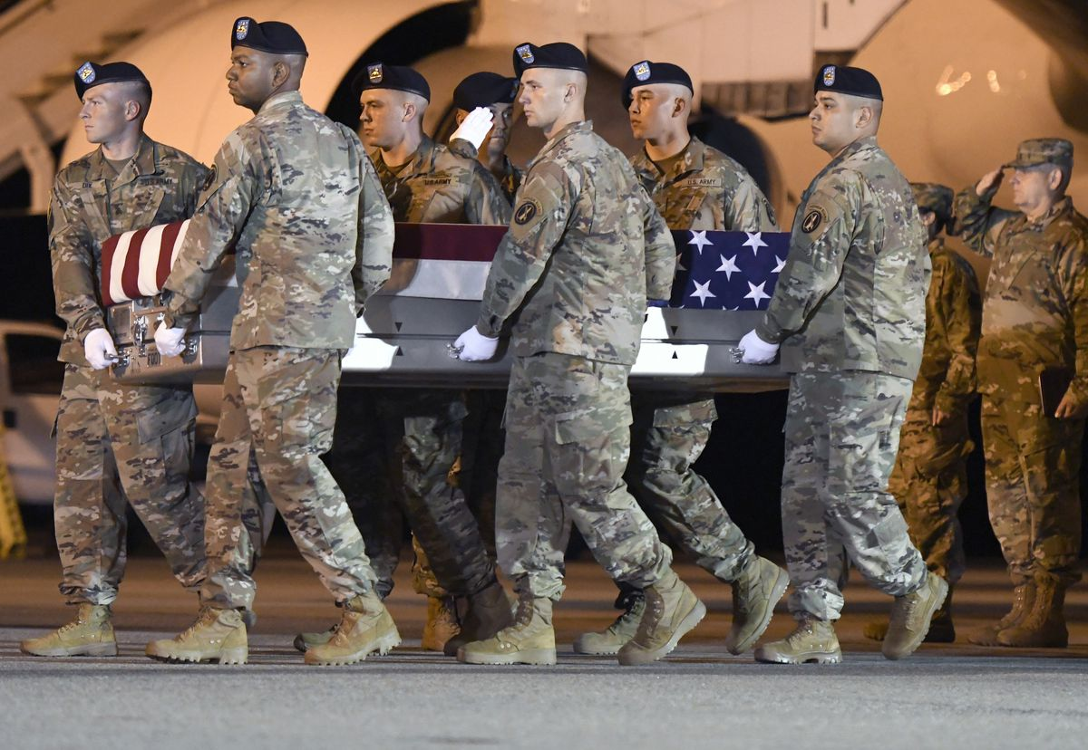 Army Spc. Michael I. Nance's remains are carried off of a transport plane Wednesday, July 31, 2019, at Dover Air Force Base, Delaware.