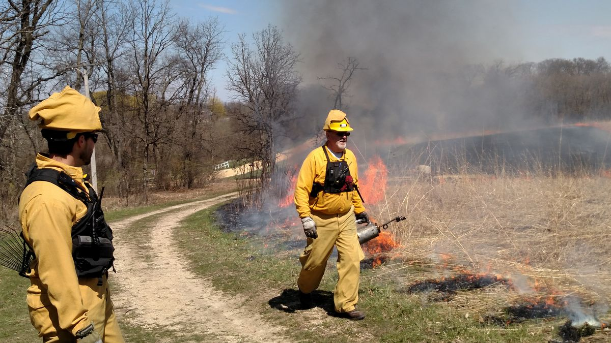 Crew boss Cody Considine oversees the start of ignition, by John Heneghan, of a burn at Franklin Creek State Natural Area.<br>Credit: Dale Bowman