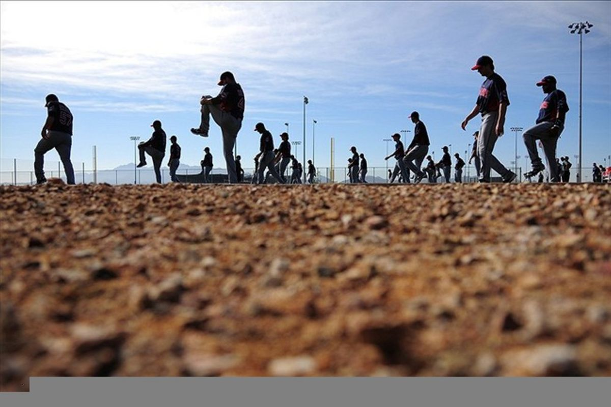 February 22, 2012; Goodyear, AZ, USA; Cleveland Indians pitchers and catchers stretch during spring training at Goodyear Ballpark. Mandatory Credit: Kyle Terada-US PRESSWIRE
