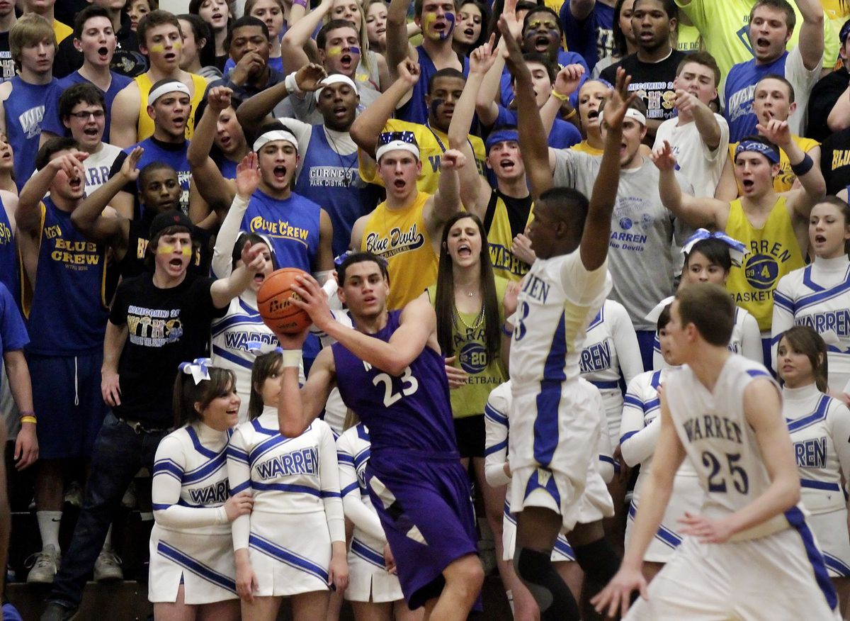 The Blue Crew, the Warren student section, focuses their attentions on Niles North's Abdel Nader.