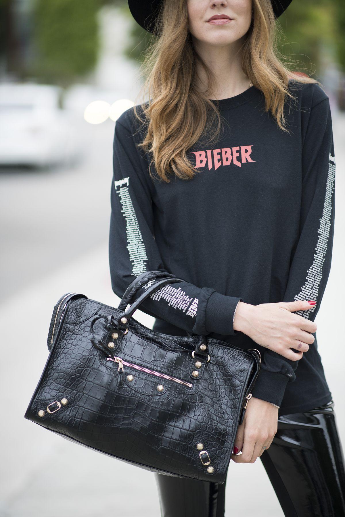 A woman in a black Justin Bieber tour shirt.