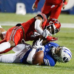 BYU and Utah compete during the first half of an NCAA college football game at LaVell Edwards Stadium in Provo on Saturday, Sept. 11, 2021.