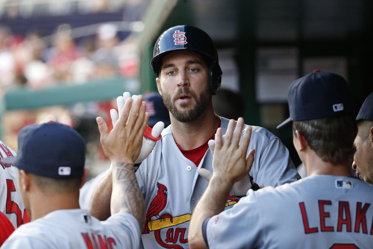 Adam Wainwright gives Mike Leake a run for his money in 9-4 victory.
