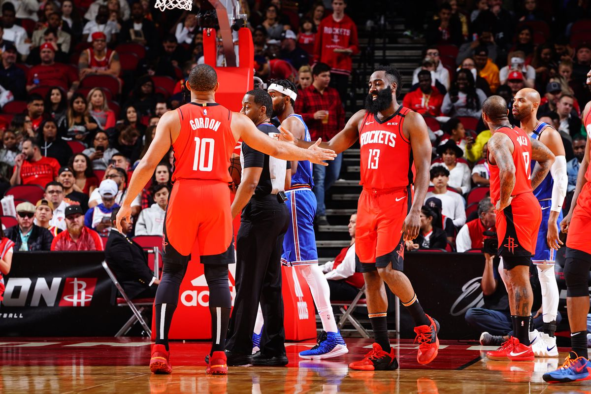 Eric Gordon  of the Houston Rockets high-fives James Harden of the Houston Rockets against the New York Knicks on February 24, 2020 at the Toyota Center in Houston, Texas.