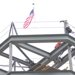 American flag atop the video board structure -