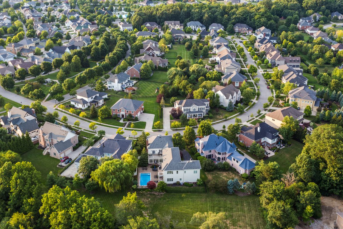 An aerial view of a suburban housing tract.