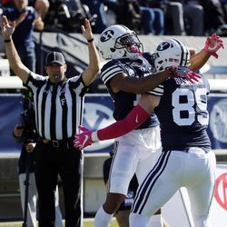 Brigham Young Cougars wide receiver Micah Simon celebrates scoring a touchdown with Brigham Young Cougars tight end Matt Bushman during NCAA football against the San Jose State Spartans in Provo on Saturday, Oct. 28, 2017.