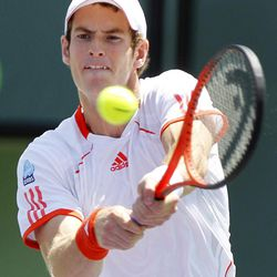 Andy Murray, of Great Britain, returns a shot Novak Djokovic, of Serbia, during the men's singles final match at the Sony Ericsson Open tennis tournament on Sunday, April 1, 2012, in Key Biscayne, Fla.
