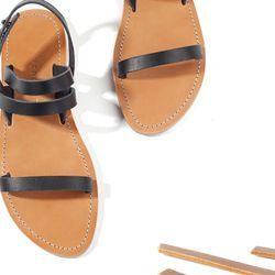 "<a href=""https://www.everlane.com/collections/summer-sandal/products/womens-sandal-black"">Summer Sandal</a>, $105 at Everlane"