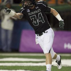 Hawaii runningback John Lister reacts after making a touchdown during the second quarter of the NCAA game between the Lamar and Hawaii, Sept. 15, 2012 in Honolulu.