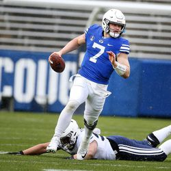 BYU's QB Beau Hoge runs during the Blue-White game at LaVell Edwards Stadium in Provo on Saturday, April 7, 2018.