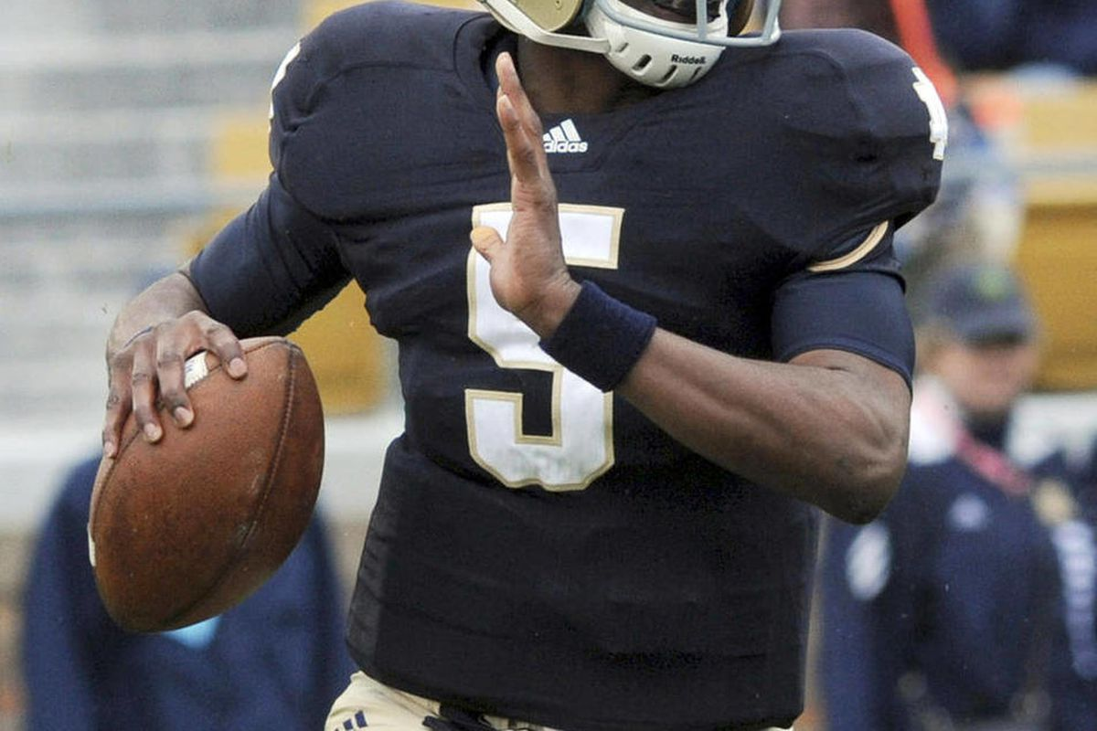 FILE - In this April 16, 2011, file photo, Notre Dame quarterback Everett Golson sprints out of the pocket during the first half of a spring NCAA college football game in South Bend, Ind.  Coach Brian Kelly wanted Everett Golson to hear some words that wo
