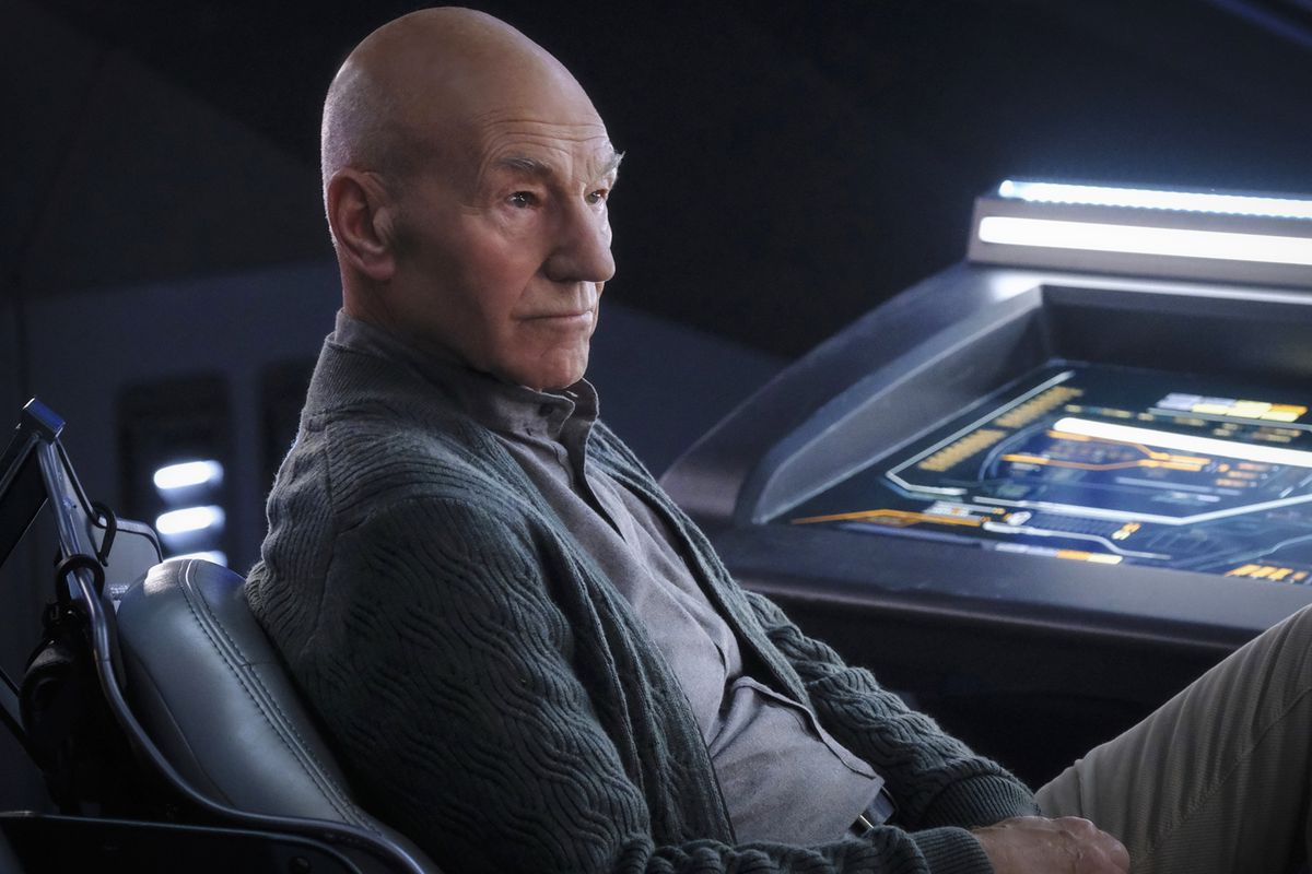 Captain Picard sits down at a Star Trek control panel