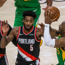 Utah Jazz guard Donovan Mitchell (45) shoots over the Portland Trail Blazers during the game at Vivint Smart Home Arena in Salt Lake City on Thursday, April 8, 2021.