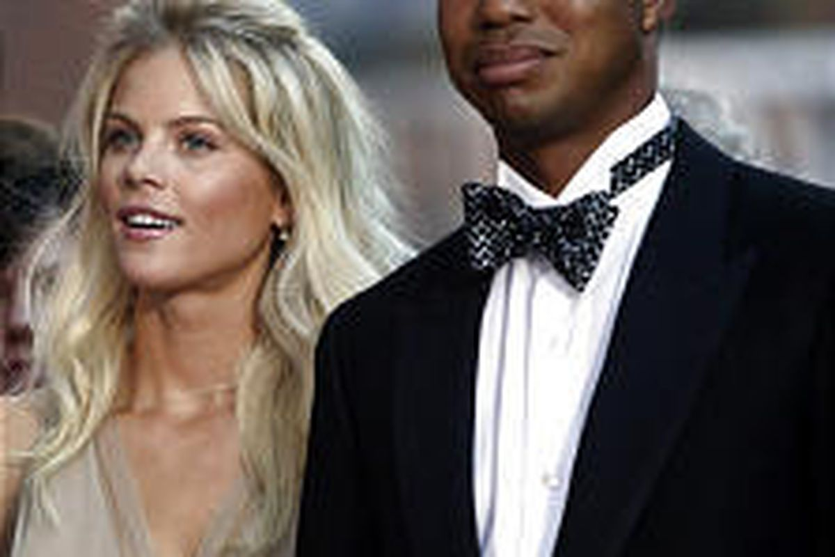 Rumor has it Tiger Woods, here with girlfriend Elin Nordegren at a Ryder Cup dinner, will marry the Swedish model while on vacation in Barbados this week. Woods says he's planning on snorkeling.