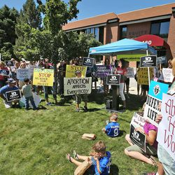 A group called Women Betrayed holds a rally to support ending taxpayer funding of Planned Parenthood in front of the Planned Parenthood offices, July 28, 2015, in Salt Lake City.