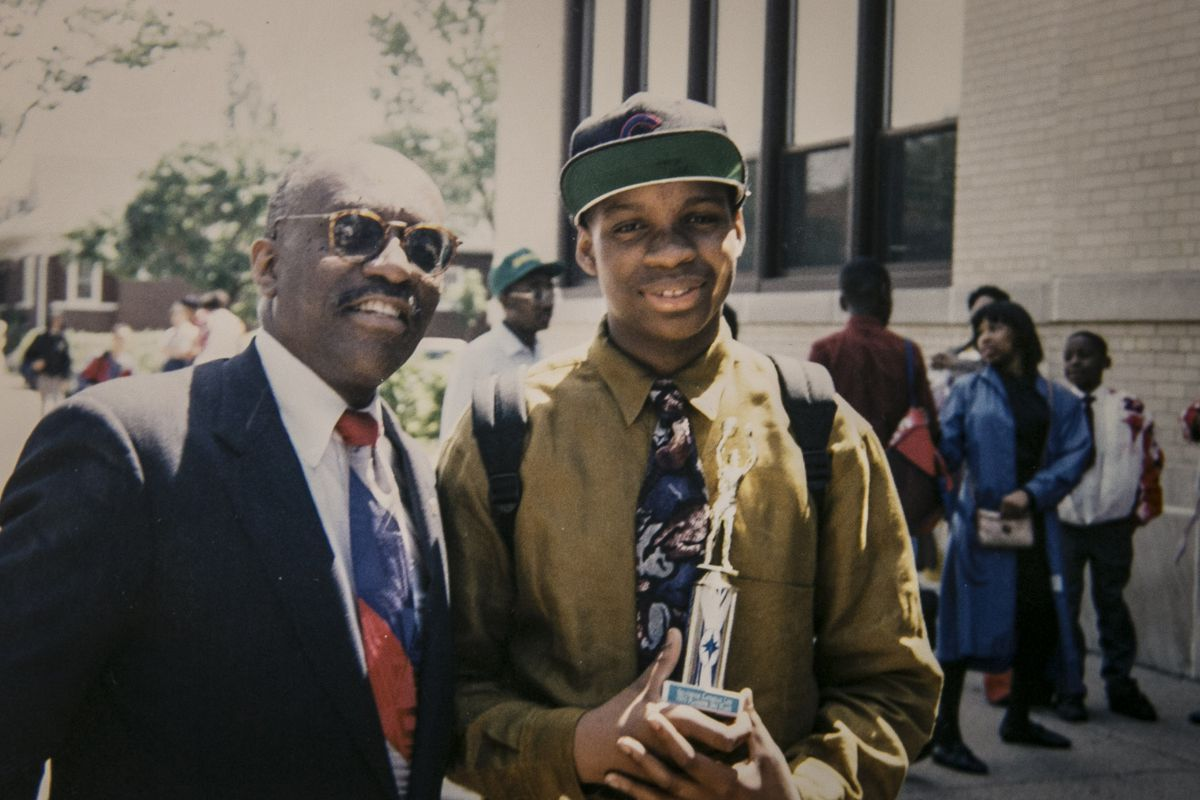 Evan F. Moore and his father after Evan's 8th grade graduation from St. Dorothy Catholic School in June of 1993.   Provided