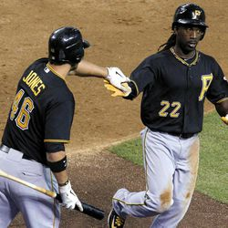 Pittsburgh Pirates' Andrew McCutchen (22) gets a high-five from teammate Garrett Jones (46) after scoring a run against the Arizona Diamondbacks during the third inning of a baseball game Tuesday, April 17, 2012, in Phoenix.