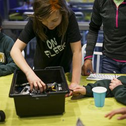 Emma Hopper builds robots out of Lego blocks during a Lego Camp at Zaniac Learning in Salt Lake City on Monday, Feb. 20, 2017.