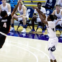 Brigham Young Cougars guard Brandon Averette (4) sinks a three over Pacific Tigers during double overtime at the Marriott Center in Provo on Saturday, Jan. 30, 2021.