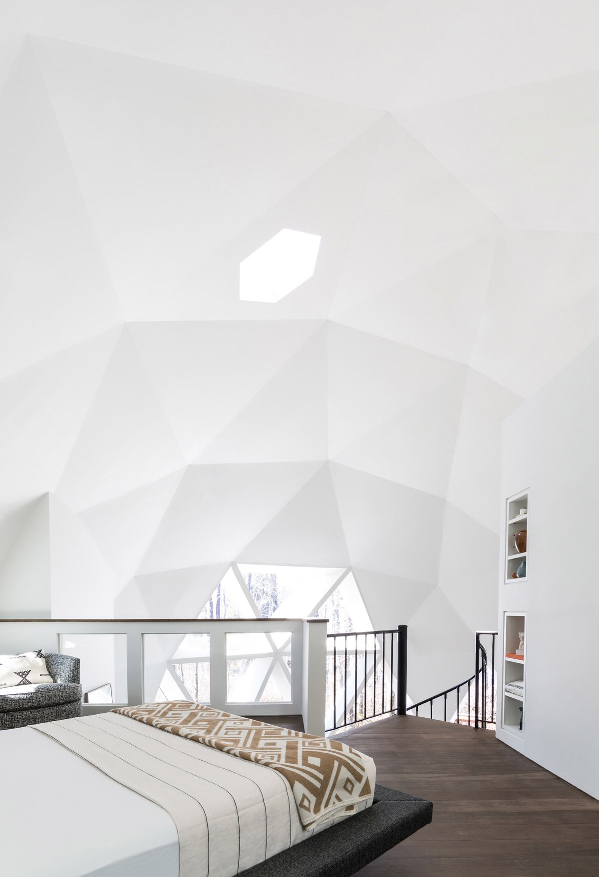 Lofted bedroom in a dome home.