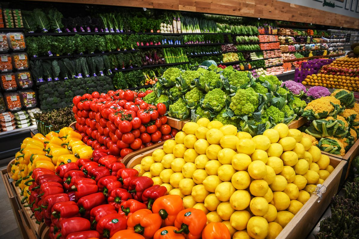 Fruits and vegetables are stacked neatly inside the produce area as employees prepare for the grand opening of a Whole Foods Market in Commack, New York, on April 2, 2019.