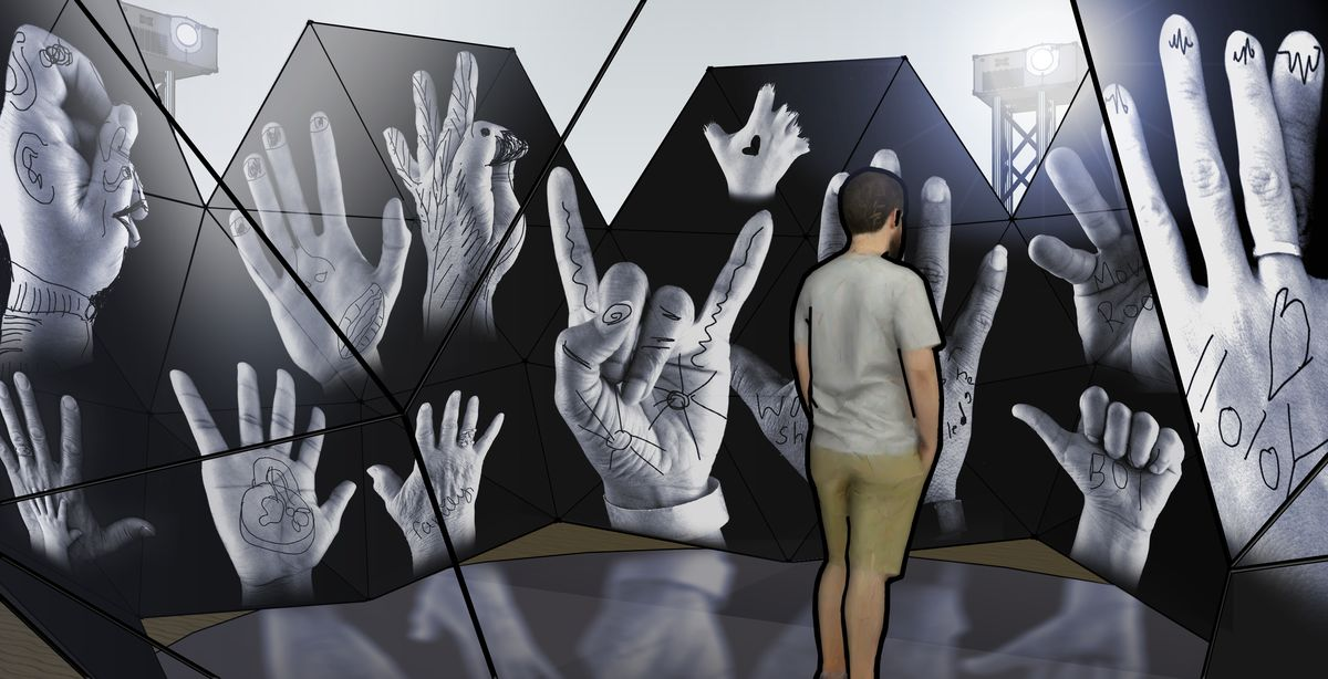 Person standing in front of projection of hands
