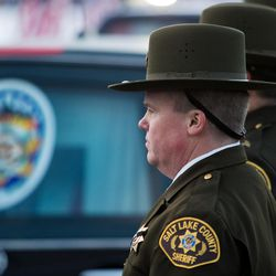 Law enforcement officers wait to carry Unified police officer Doug Barney's casket into the Maverik Center in West Valley City on Monday, Jan. 25, 2016, prior to his funeral.