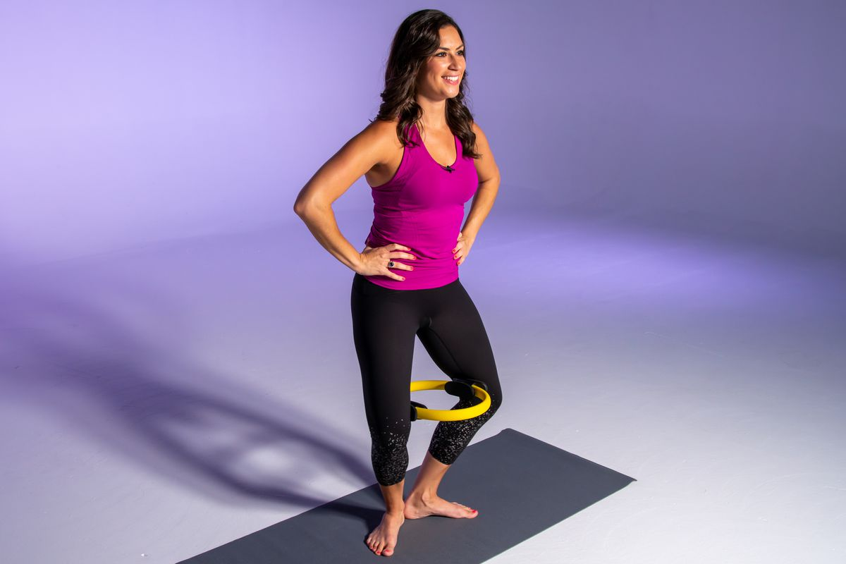 """A standing """"v"""" squeeze with a Pilates ring will give your thighs a great inner-stretch/workout."""
