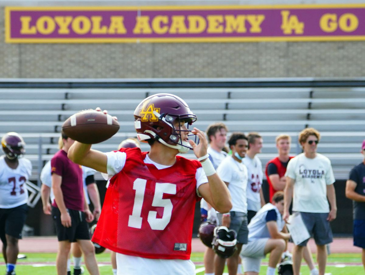 Loyola quarterback Jake Stearney (15) looks for his receivers at practice in Wilmette.