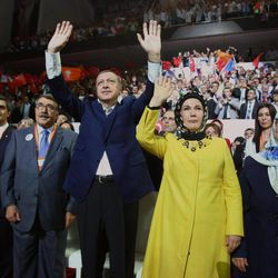 Turkish Prime Minister Recep Tayyip Erdogan and his wife Emine Erdogan salute the members of his ruling Justice and Development Party, AKP, during the congress of AKP in Ankara, Turkey, Sunday, Sept. 30, 2012. Erdogan said Sunday that the era of military coups in the country is over and that Turkey is a model for other Muslim countries to emulate.