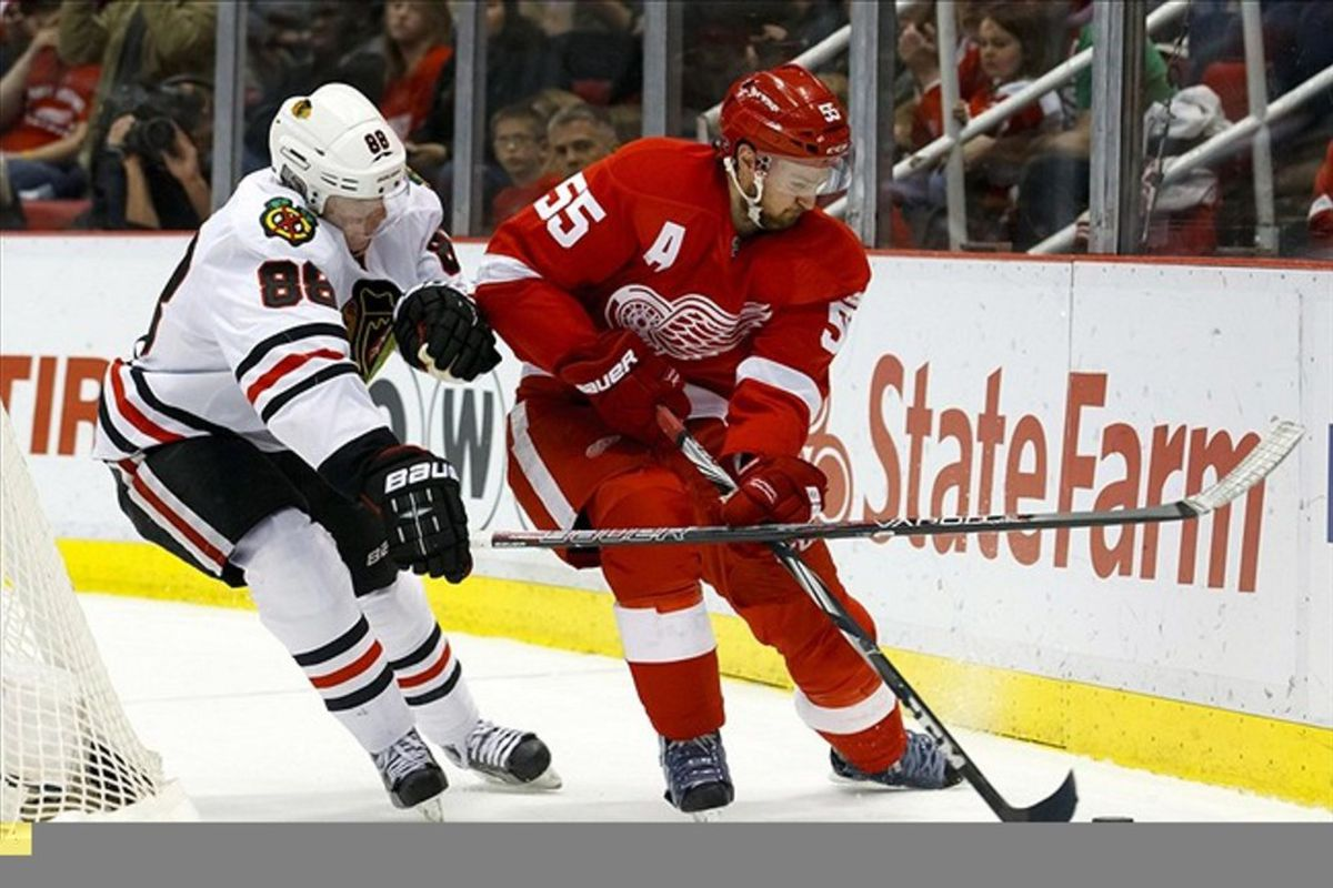 March 4, 2012; Detroit, MI, USA; Chicago Blackhawks right wing Patrick Kane (88) and Detroit Red Wings defenseman Niklas Kronwall (55) battle for the puck in the second period at Joe Louis Arena. Mandatory Credit: Rick Osentoski-US PRESSWIRE