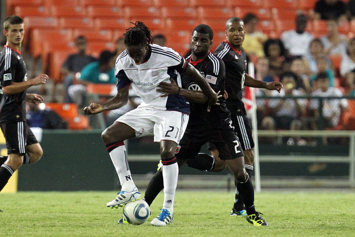WASHINGTON, DC - JULY 20: Shalrie Joseph #21 of the New England Revolution controls the ball against Brandon McDonald #2 of D.C. United at RFK Stadium on July 20, 2011 in Washington, DC. (Photo by Ned Dishman/Getty Images)