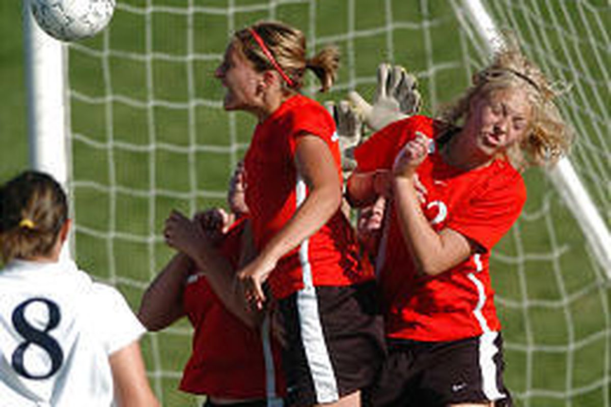 North Sanpete's Denise Montano, left, and Chelsee Morley, right, try to help goalkeeper Brittany Campbell keep the ball out of the net Thursday afternoon. Despite their efforts, Juan Diego won the game, 9-0.