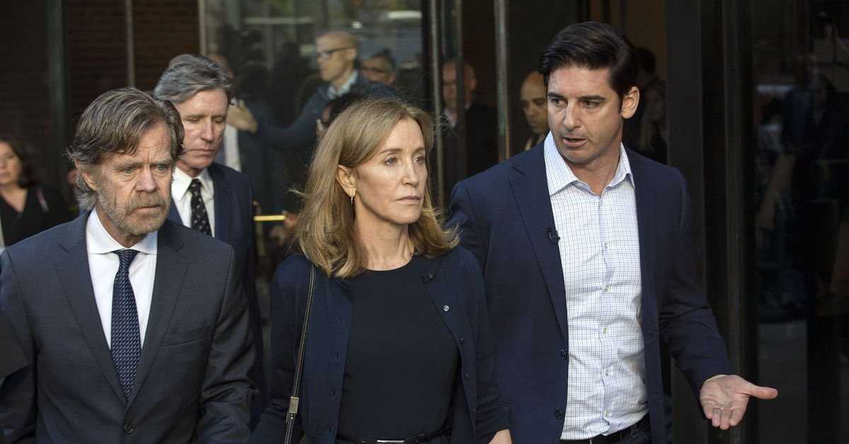 Felicity Huffman sentenced to 14 days in a college admissions case that raises questions of race and class