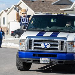 Cosmo the Cougar follows Brandon Stewart as he goes for a ride in BYU football's equipment semi in Clinton on Saturday, Jan. 30, 2021. The ride was his final wish as he battles cancer.