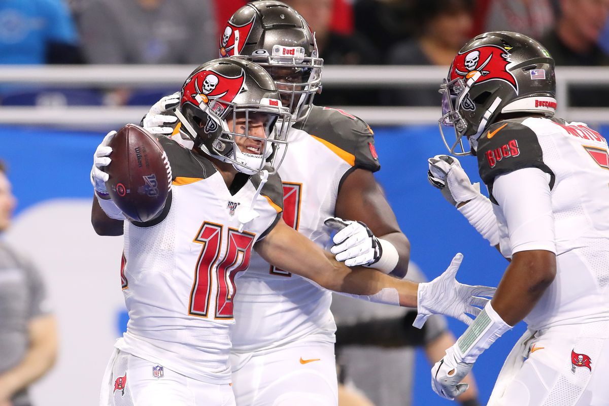 Scott Miller of the Tampa Bay Buccaneers celebrates his first half touchdown with Jameis Winston while playing the Detroit Lions at Ford Field on December 15, 2019 in Detroit, Michigan.