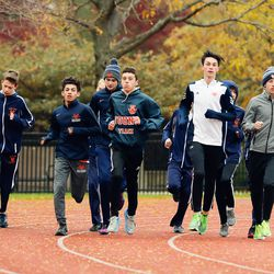 Young cross country runners warm up before the meet at River Park.