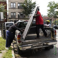 An old Chicago Housing Authority sign that sat outside the sole remaining building from the Jane Addams Homes in the 1300 block of West Taylor Street is taken into storage, Wednesday, Aug. 21, 2019. The sign once hung at the Robert Taylor Homes, but there are no immediate plans for its restoration or display after years of neglect.