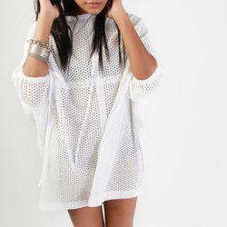 """<b>Malia Mills</b> Tatiana Tunic in White, <a href=""""http://www.maliamills.com/tunics-tops/malia-mills-tatiana-tunic/w1/i1045398_1007186/"""">$295</a>"""